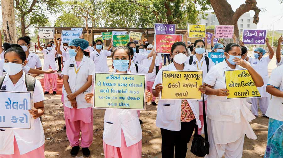 Government Civil Hospital nurses protest for salary hike on International Nurses Day in Ahmedabad on Wednesday.