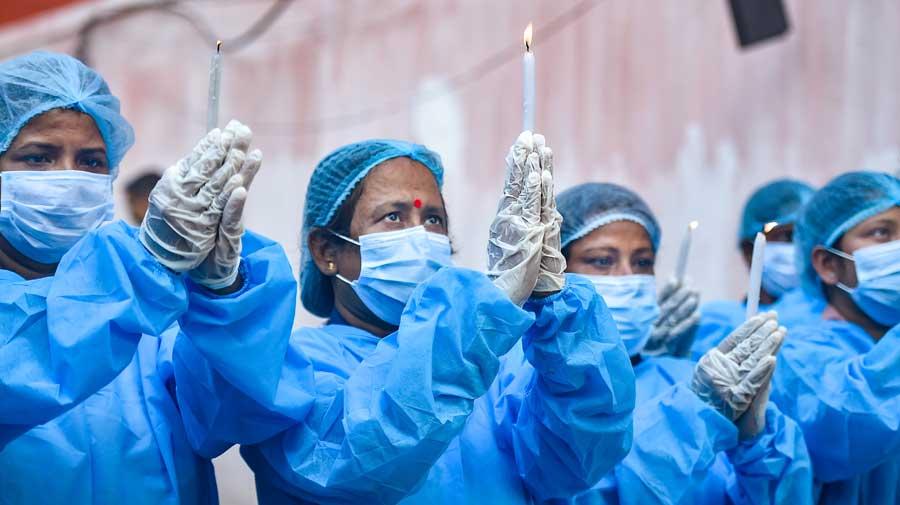 Nurses offer prayers to Florence Nightingale in Calcutta on Wednesday.