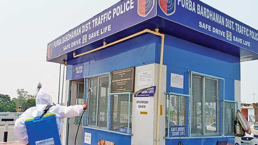 A sanitisation drive underway at a traffic kiosk in Burdwan.
