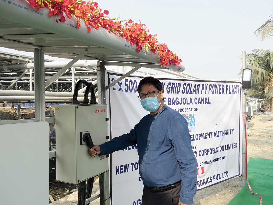 NKDA chairman Debashis Sen switches on the solar plant on May 1. The light affixed to the pole to the right uses solar power produced in it.