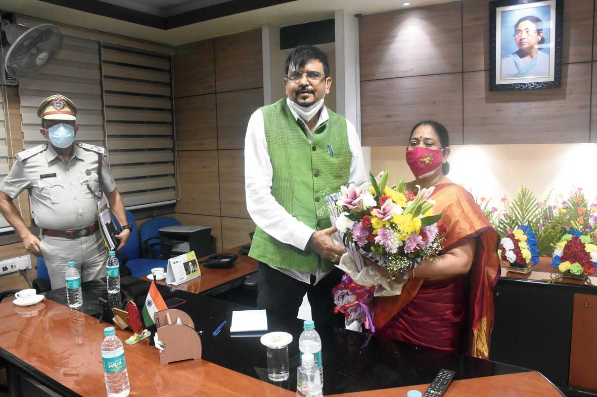 Bidhannagar MLA Sujit Bose being greeted on his first day in office on Tuesday after swearing in as minister of fire and emergency services by Krishna Chakraborty, the recently reinstated chairperson of the Board of Administrators, Bidhannagar Municipal Corporation.