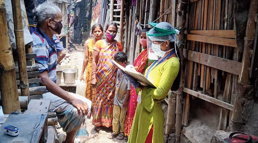 A health worker collects information in the community.