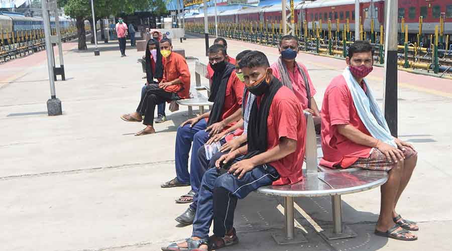 Porters wait for passengers at Dhanbad railway station on Saturday.