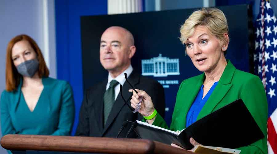 Secretary of Energy Jennifer Granholm briefs reporters as Secretary of Homeland Security Alejandro Mayorkas, and White House Press Secretary Jen Psaki look on
