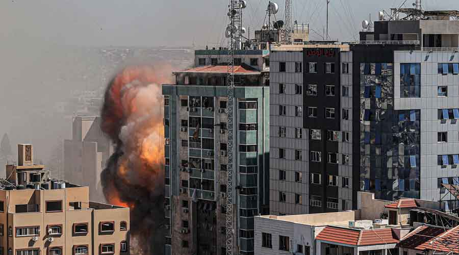An Israeli airstrike destroys a high-rise building in Gaza City, Gaza Strip, that housed media outlets including The Associated Press and Al Jazeera