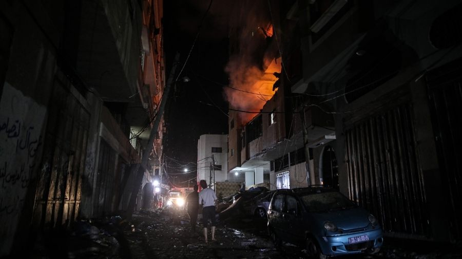 A fire burns in apartment building in Gaza City, Gaza Strip, Friday evening.