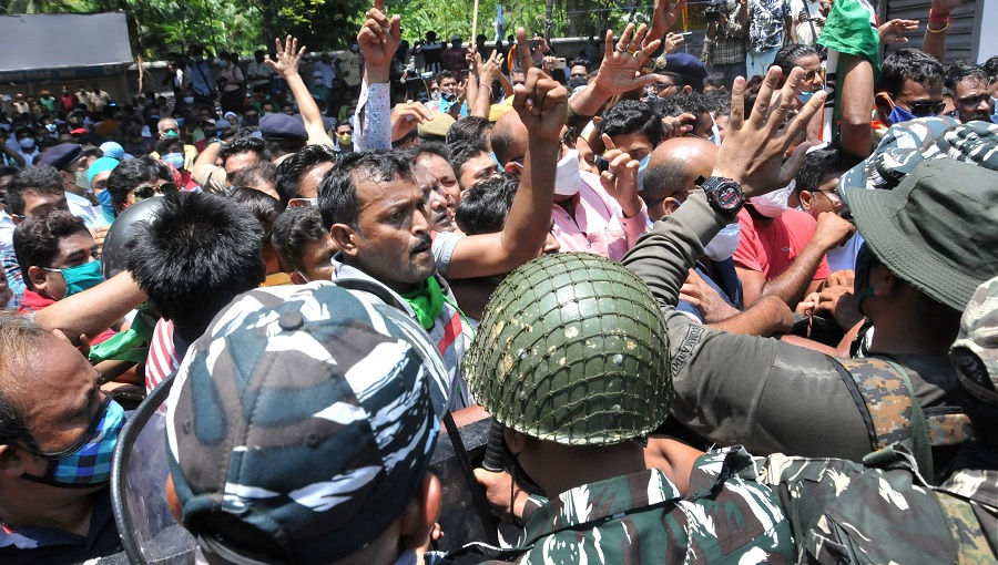 Security personnel stop Trinamool Congress workers who were protesting at the CBI office at Nizam Palace, in Calcutta on Monday.
