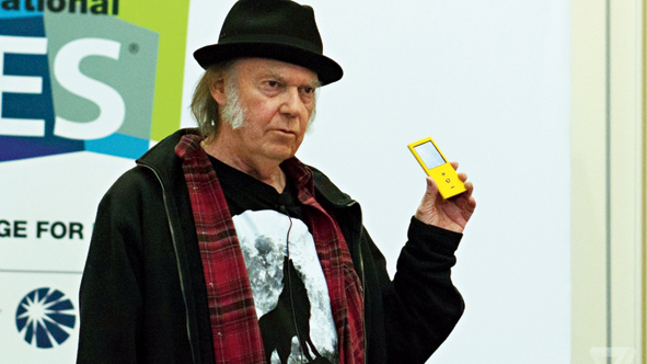 File picture of Neil Young with his lossless audio solution — Pono.