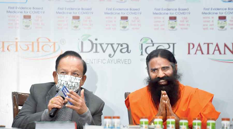 Union health minister Harsh Vardhan with Ramdev at a news conference marking the launch of Coronil in New Delhi.