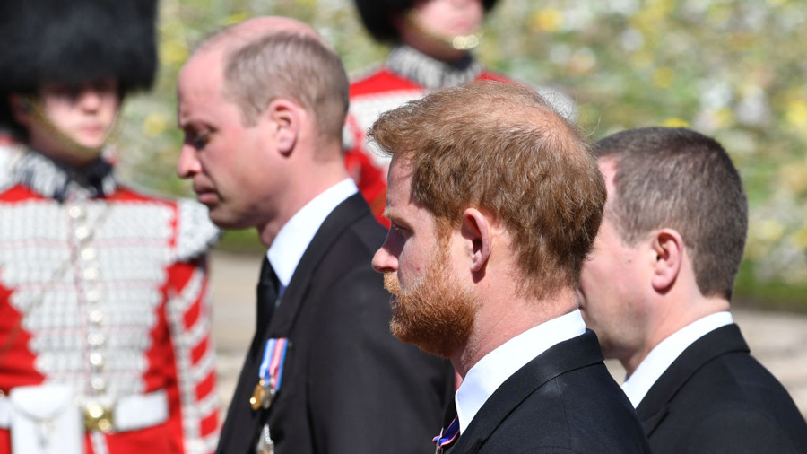 Prince William, Duke of Cambridge; Prince Harry, Duke of Sussex and Peter Phillips walk behind Prince Philip, Duke of Edinburgh's coffin, carried by a Land rover hearse, in a procession during the funeral of Prince Philip, Duke of Edinburgh at Windsor Castle on April 17, 2021 in Windsor, United Kingdom.