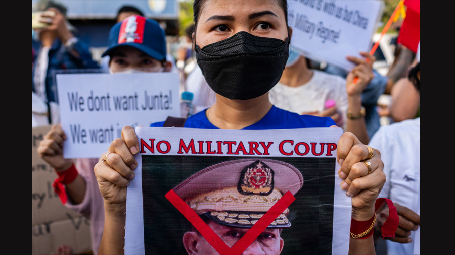 Protesters hold banners against the military coup and in favor of democracy outside the Russian embassy on February 12, 2021 in Yangon, Myanmar.