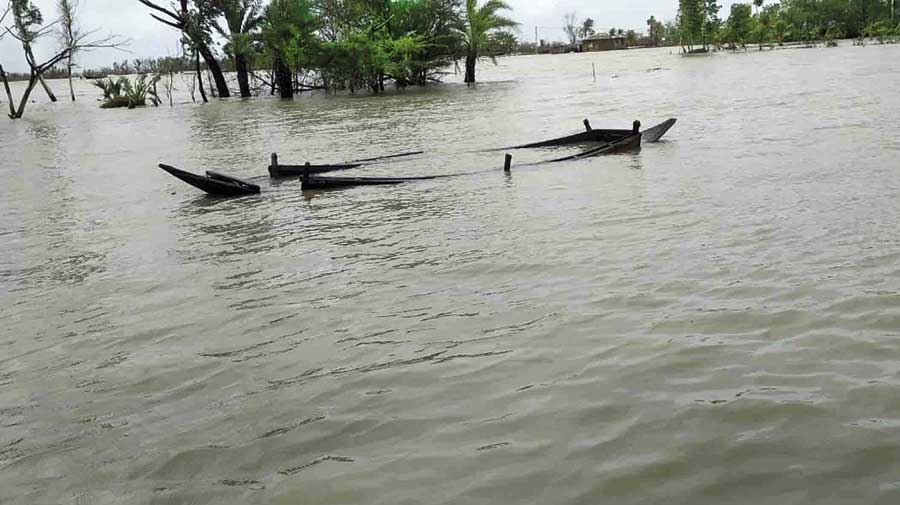 THIS BOAT IS SITTING ON LAND, NOT IN THE RIVER: A submerged boat, which had been moored to the banks as a precaution, shows the sweep of the inundation of Bankimnagar village at Sagar in South  24-Parganas on Wednesday.  The impact of Cyclone Yaas sent water surging from  the sea, flooding the  village located around 118km from Calcutta