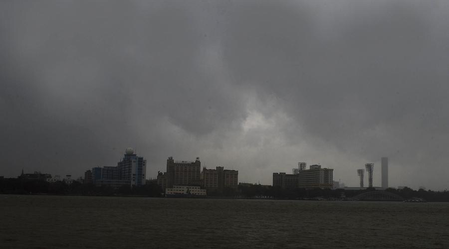10.45am: Rain and dark clouds over Calcutta, seen from Ramkrishna Ghat, Howrah, on Wednesday