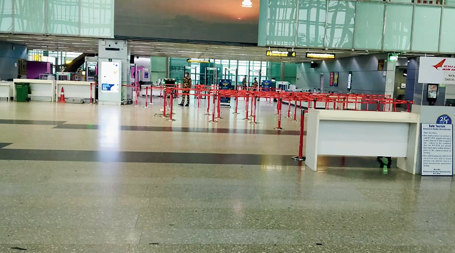 Calcutta airport wears a deserted look on Wednesday morning. Fights were suspended from 8am to 7.45pm as a precaution against Cyclone Yaas.