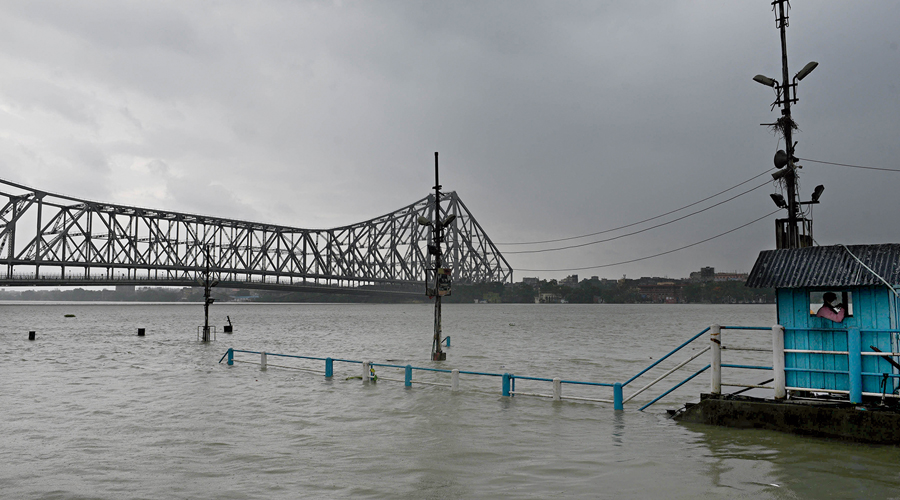 Water flows over the stairs of the Howrah Launch Ghat during  high tide on Wednesday.