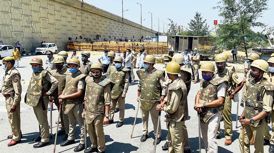 Police officers stand guard near the farmer  protest site at Delhi's Ghazipur border on Wednesday.