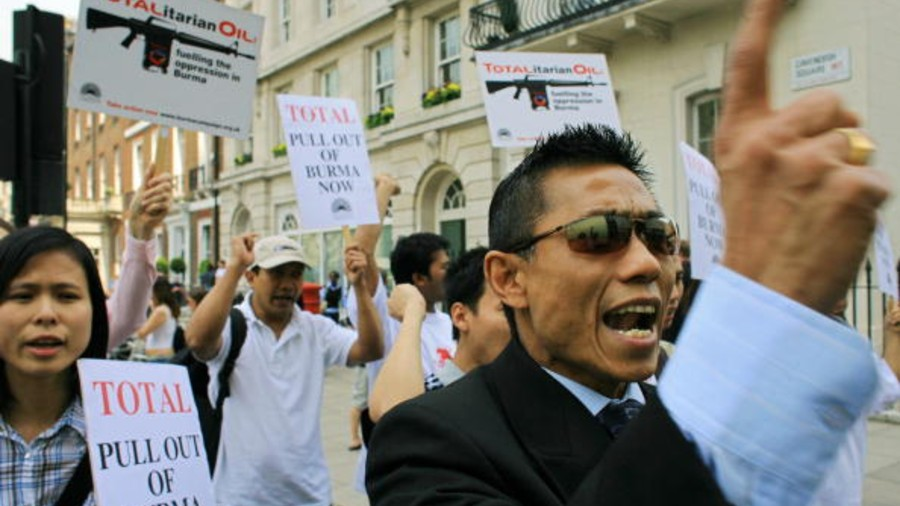 Campaigners from the 'Burma Campaign UK' demonstrate outside the Total Oil offices in Cavendish Square in London.