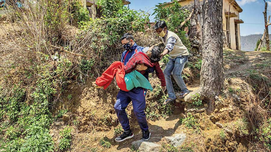 The journey to the dispensary on the tough terrain before they found a creaky taxi.