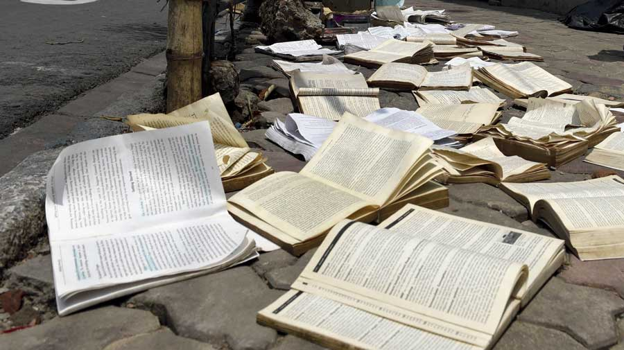 Wet books put out to dry at the College Street book market on Friday, a day after the city received heavy rain.