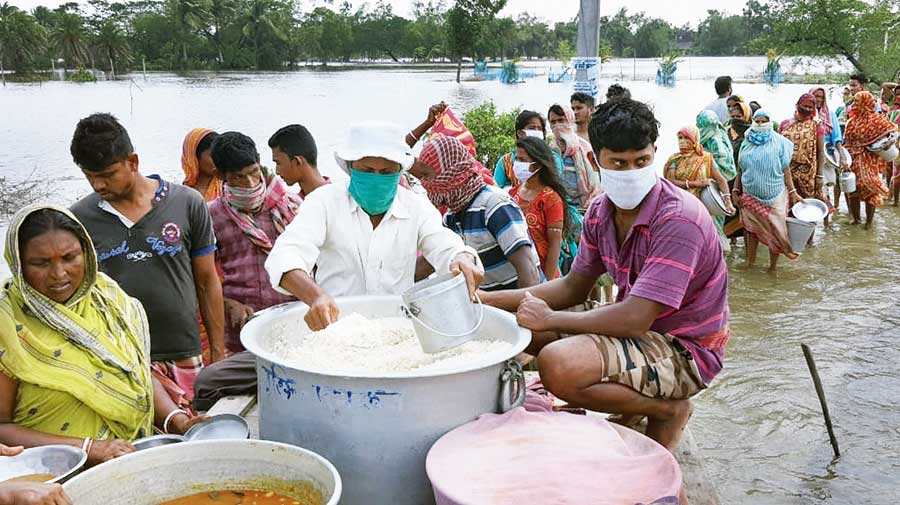 Food being distributed among Sunderbans residents at a camp organised by Mukti, an NGO, at Nagendrapur village in the Mathurapur II block on Friday