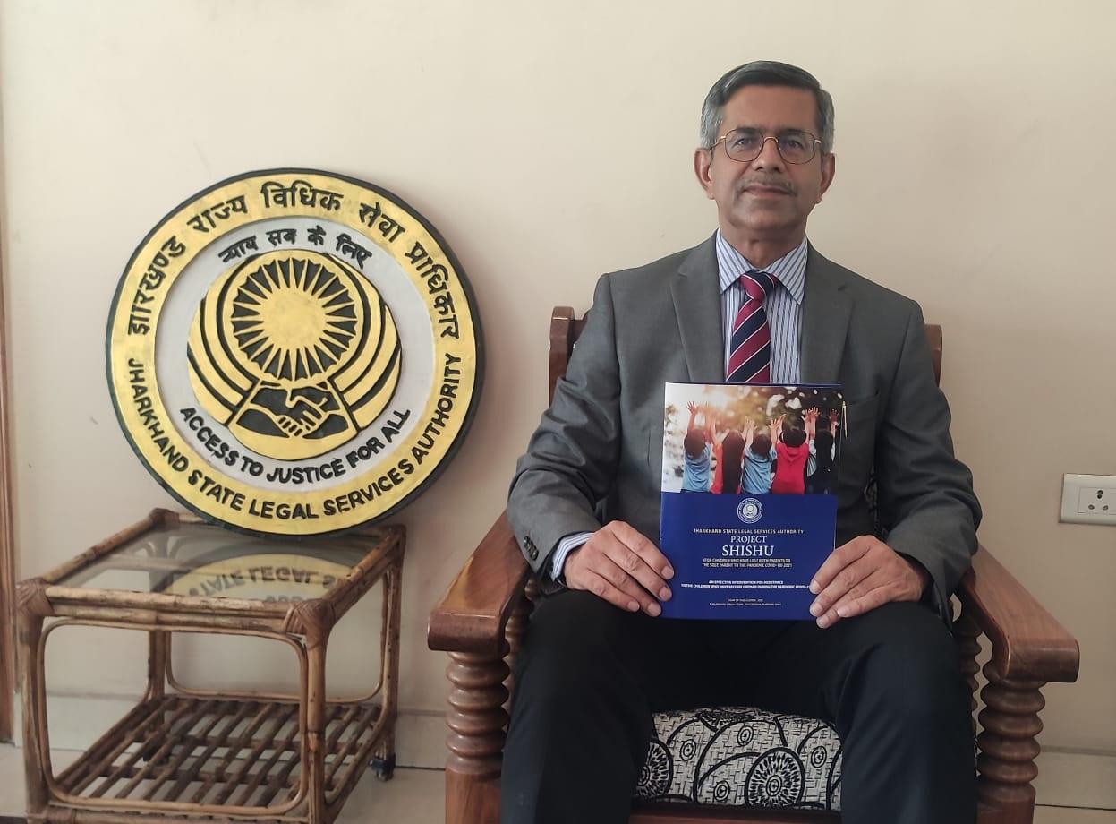 High court judge Aparesh Kumar Singh with the brochure of Project Sishu on Monday.