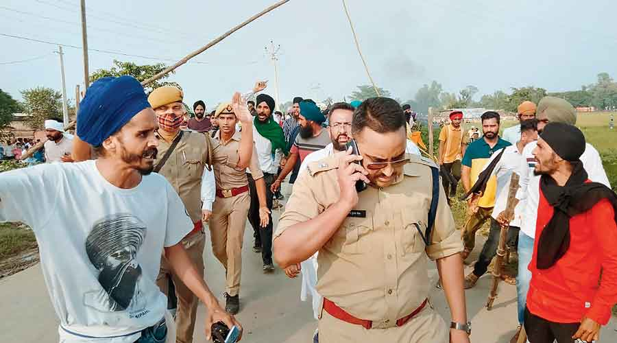 Farmers protest after two of the agitators were allegedly run over by a vehicle in the convoy of a Union minister in Lakhimpur Kheri on Sunday.