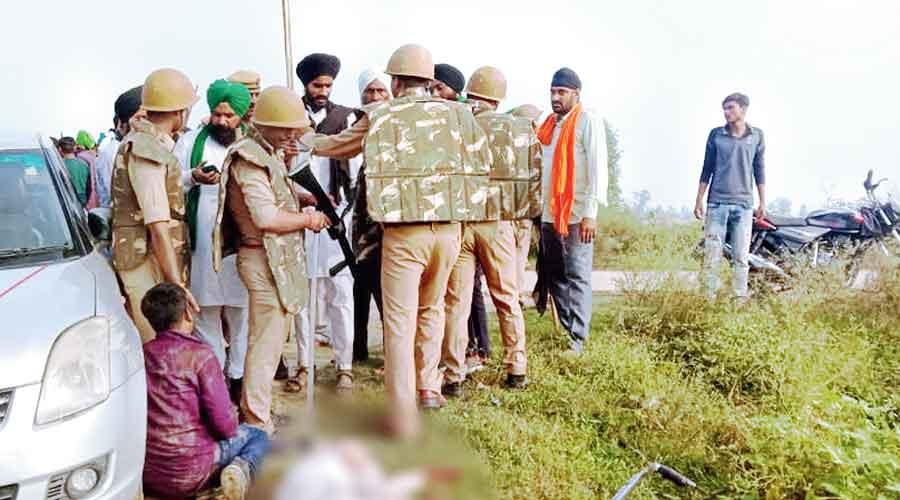 Security personnel keep vigil after violence broke out in Lakhimpur Kheri on Sunday.