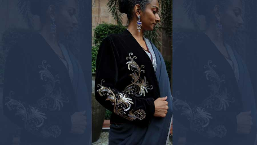 Black velvet jacket with silver dragon embroidery lined with inset Ikat silk