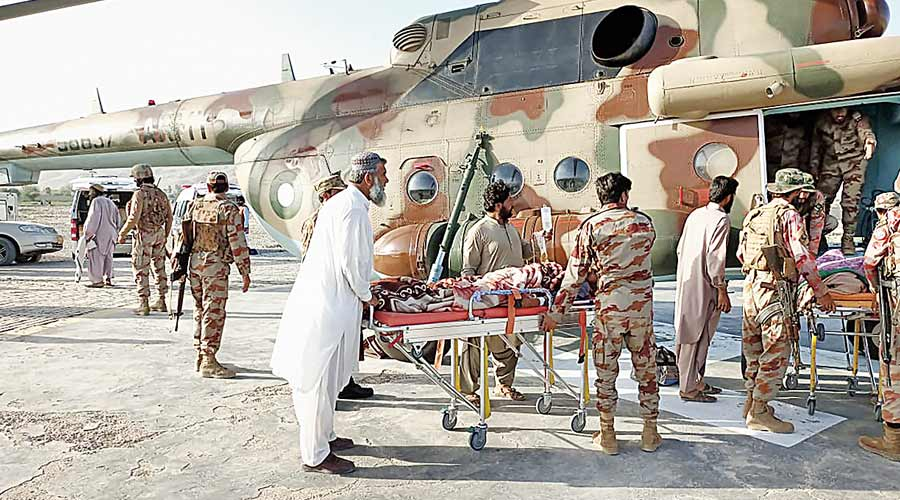 Injured survivors are transported in a Pakistan army helicopter after the earthquake in Harnai, 100km from Quetta.
