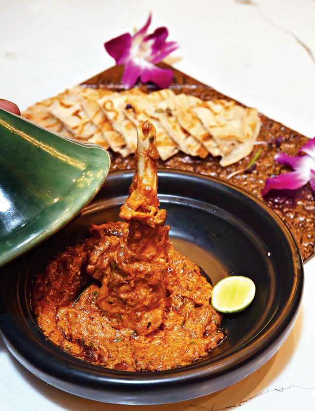 The lamb shank is not to be missed and certainly one of the most delicious dishes on the menu.  Cooked for several hours, this one is dipped in a creamy and flavorful curry and served with hot Malabar paratha.