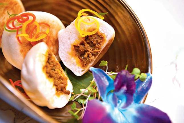Kosha Mangsho Bao are freshly made, soft and chewy, stuffed with the famous Bengali kosha mangsho as a garnish.