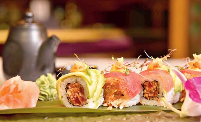 The tuna crisp is a must-have for any sushi lover.  Little modified, this one has a tuna roll stuffed with chunks of tuna and tanuki wrapped in avocado and thin slices of tuna with tobanjan aioli on top.