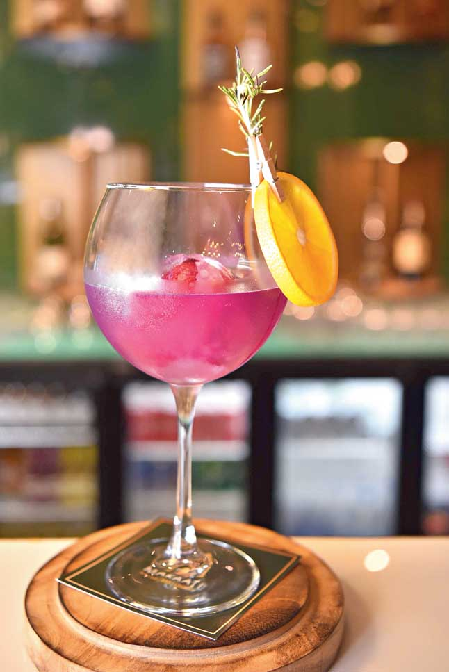 Royal Purple is a gin-based cocktail infused with herbs like rosemary, many flowers and topped with a scoop of rose ice cream.  Aromatic and smooth, this one is our favorite!