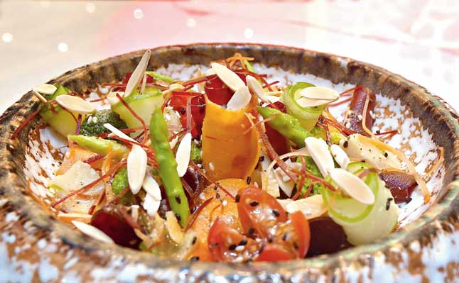 Say goodbye to boring salads with House Salad - a healthy dish that features crunchy curls of broccoli, asparagus, bamboo shoots that are mixed with homemade lemon mustard and topped with sesame seeds and toasted blanched almonds which give a nutty taste