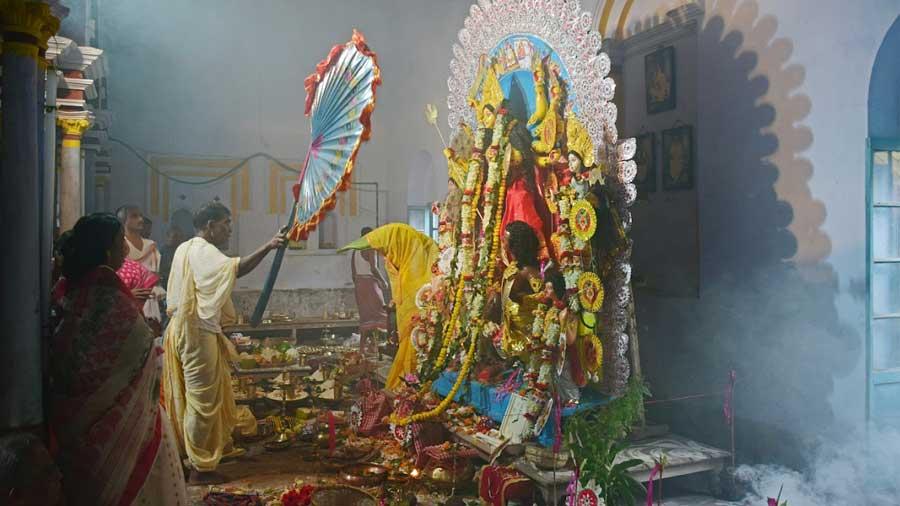 Arati of the idol. Durga Puja began at this palatial house in 1934
