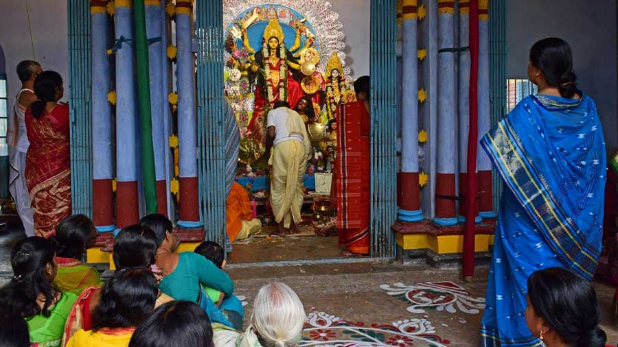 The entire village participates in the puja