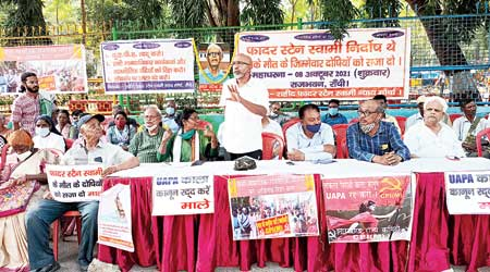 Social and right activists along with Left parties' members sit on a dharna near Raj Bhavan in Ranchi on Friday to mark first year of Father Stan Swamy's arrest.