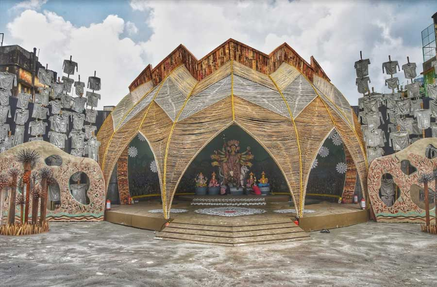 A surprise greeted pandal hoppers at Kashi Bose Lane Durga Puja, which has focussed on the imbalance in life, instead of symmetry. The pandal has a pointed polygon at the top, instead of a traditional curved dome. The pandal also has shirts with illustrations depicting lives lost in the pandemic.