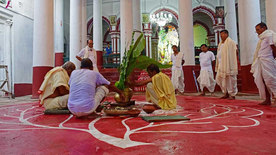 'Naba Patrika' rituals being performed in front of the 'thakur dalan'