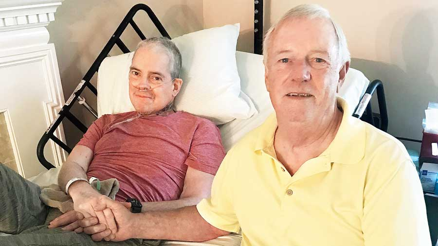 Sam Anthony (left) with his birth father, Craig Nelson, at  Anthony's home in Falls Church in August.