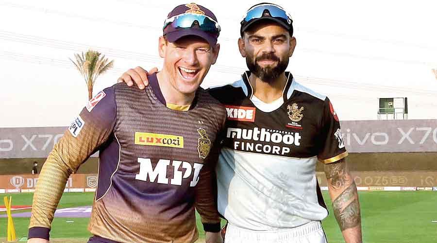 KKR captain Eoin Morgan (left) and his RCB  counterpart Virat Kohli.