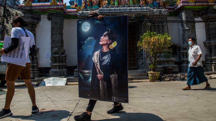 A protestor holds a portrait of Myanmar's ousted civilian leader Daw Aung San Suu Kyi in the country's capital of Yangon, Feb. 20, 2021. The military seized power in a coup on Feb. 1, and detained the country's elected civilian leaders.