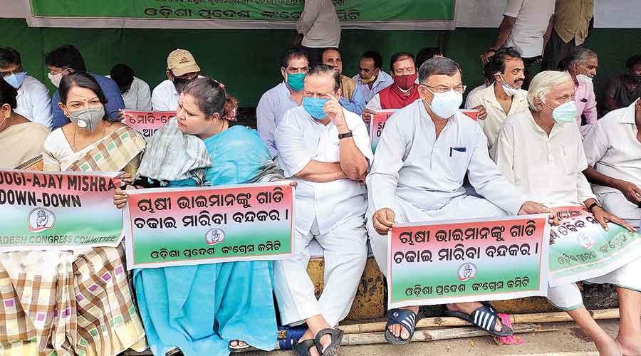 Odisha Congress leaders on a maun brata on Monday near the Raj Bhavan in Bhubaneswar