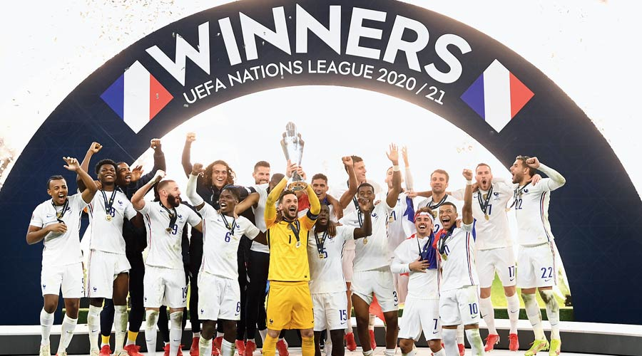 France players and support staff with the Uefa Nations League trophy at San Siro Stadium in Milan on Sunday.