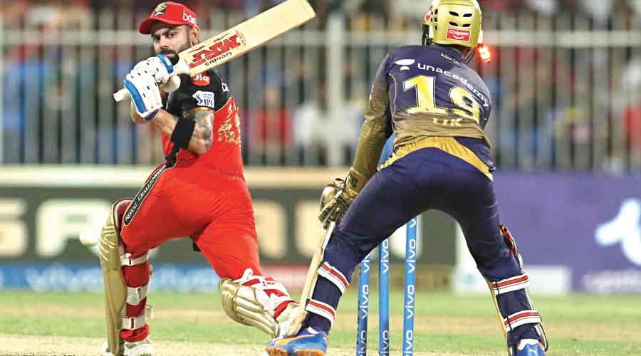 Virat Kohli is bowled by Sunil Narine during the IPL 2021 Eliminator on Monday.