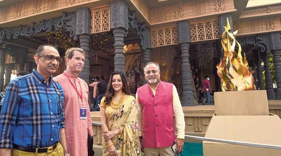 Five star puja: (From left) Imran Zaki, director, David & Goliath Films; Manfred Auster, German consul general;  actress Raima Sen; and Lal Bhatia, chairman, David & Goliath Films, at the Chetla Agrani puja .
