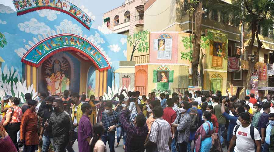 Visitors to the Badamtala Ashar Sangha pandal on Monday afternoon.