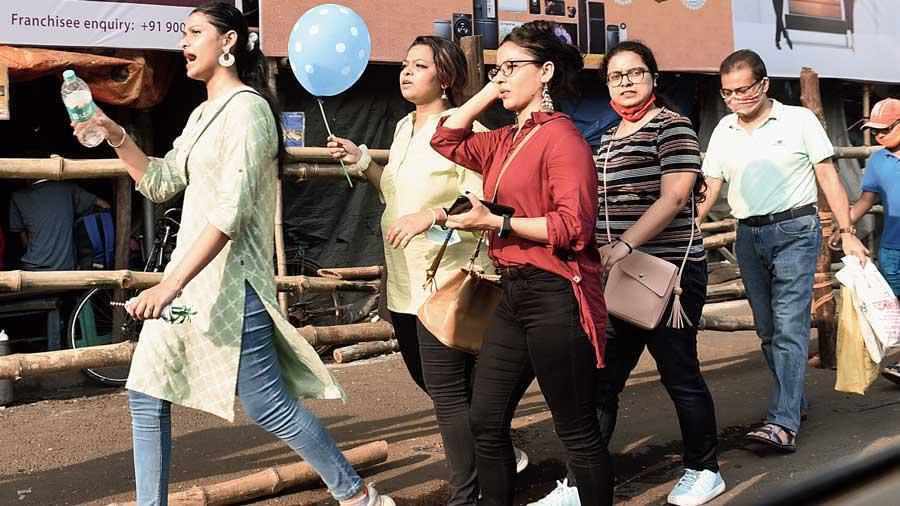 Puja revellers on Rashbehari Avenue on Tuesday