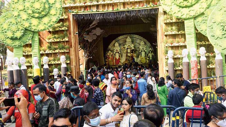 Visitors to the Singhi Park puja pandal in Gariahat on Tuesday afternoon