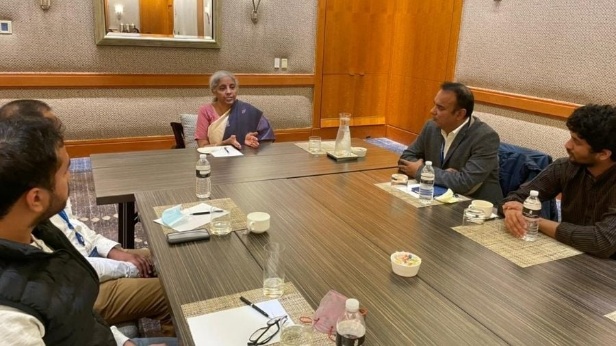 Nirmala Sitharaman interacts with delegates in Boston on Tuesday.